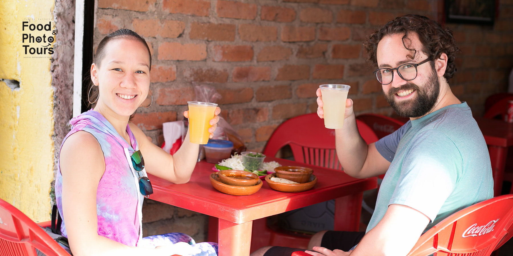 A Millenials couple eating Birria TACOS and taking a Food Tour in Puerto Vallarta, Pitillal.
